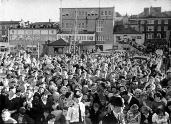 A large crowd of people on Custom House Quay